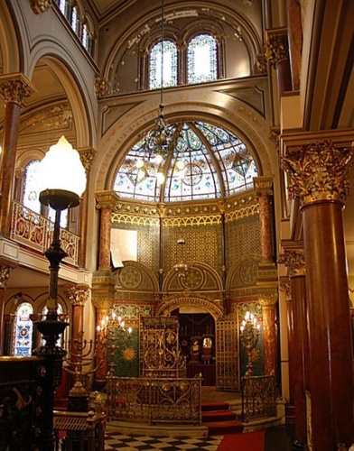 "Middle Street Synagogue.  ©Tony Mould: http://www.mybrightonandhove.org.uk.    Interior Grade II* officially described as ""an extremely sumptuous example of late 19th century craftsmanship"".  It is unique in having two stained glass windows dedicated to the memory of the Jewish wife of an English Prime Minister – Lady Rosebery, formerly Hannah Rothschild."