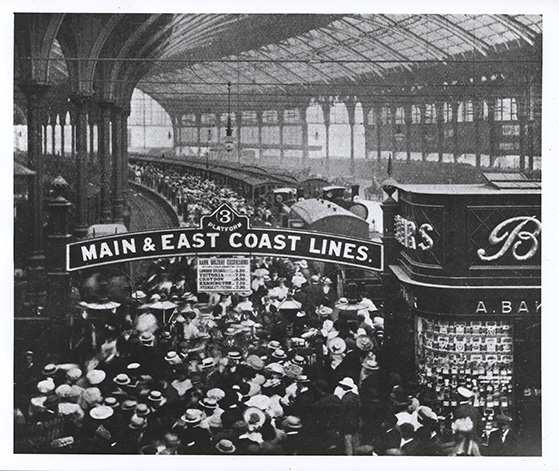 Courtesy Royal Pavilion & Museums, Brighton & Hove. c.1905 large crowd of day trippers at Brighton Station.  Excursion trains started at Easter 1844, in August of that year a massive train (80 coaches behind 8 engines) carried 2,200 Londoners to Brighton