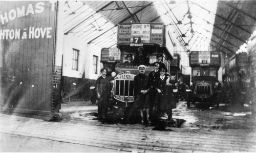 A photograph of the garage in Montague Place garage in the 1920s. These are not electrobuses. 