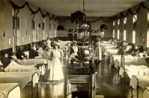 Women's ward in workhouse, maybe decorated for Christmas.
