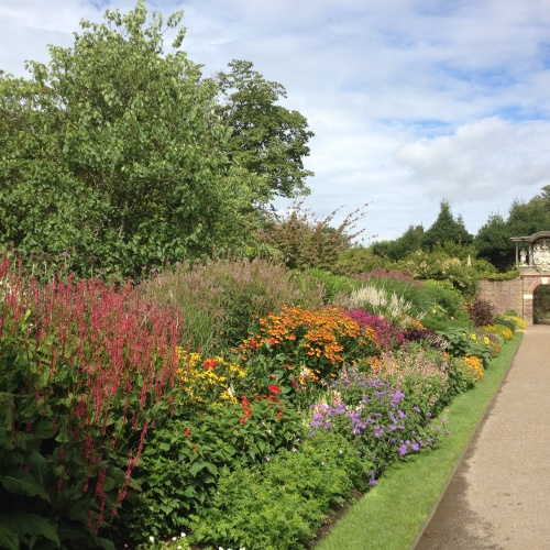( Picture is Nymans with its lovely flower beds )