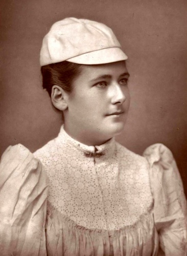 This photograph, 1891, shows Wimbledon champion Lottie Dod, in her fashionable white blouse and sporting cap: she longed for looser tennis clothes that did not hamper breathing [Wikimedia Commons]